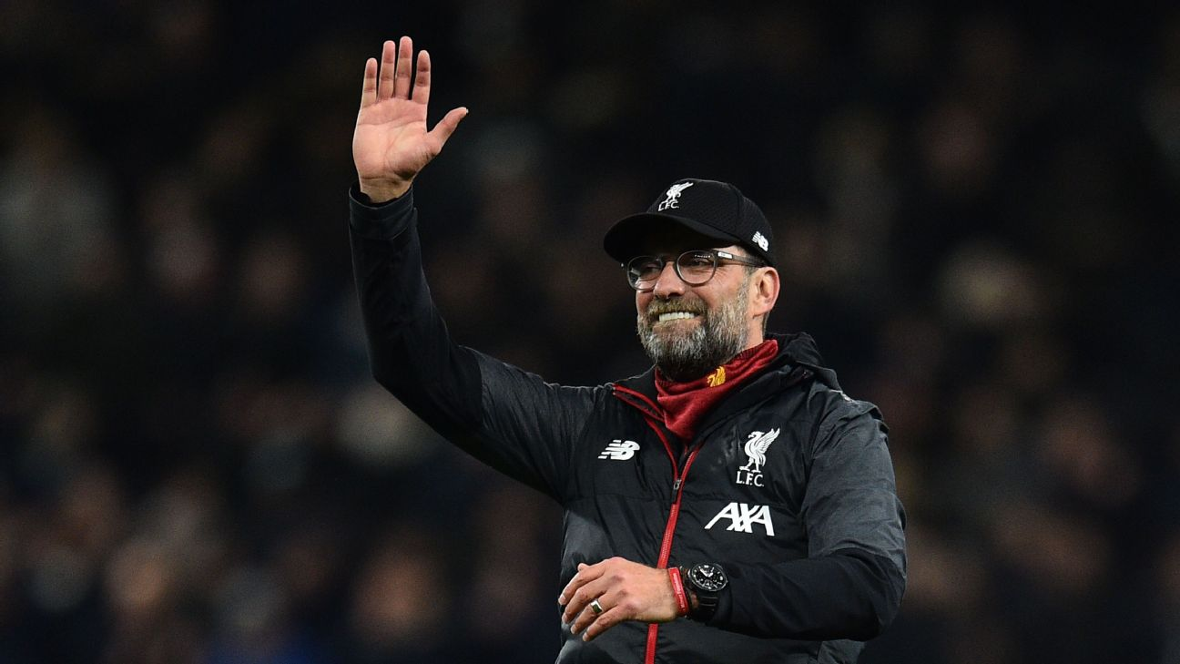 Jurgen Klopp waves to the travelling supporters after Liverpool's win over Tottenham in the Premier League.