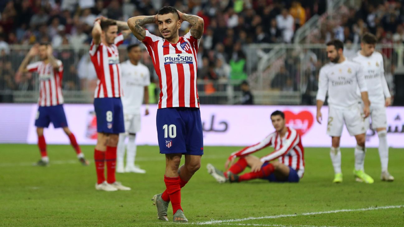 Atletico Madrid look on during their Spanish Supercopa final loss to Real Madrid.