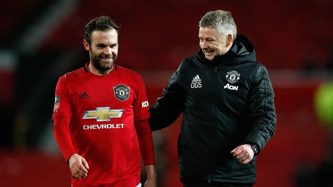 Manchester United's Juan Mata with manager Ole Gunnar Solskjaer after the FA Cup third-round replay match at Old Trafford.