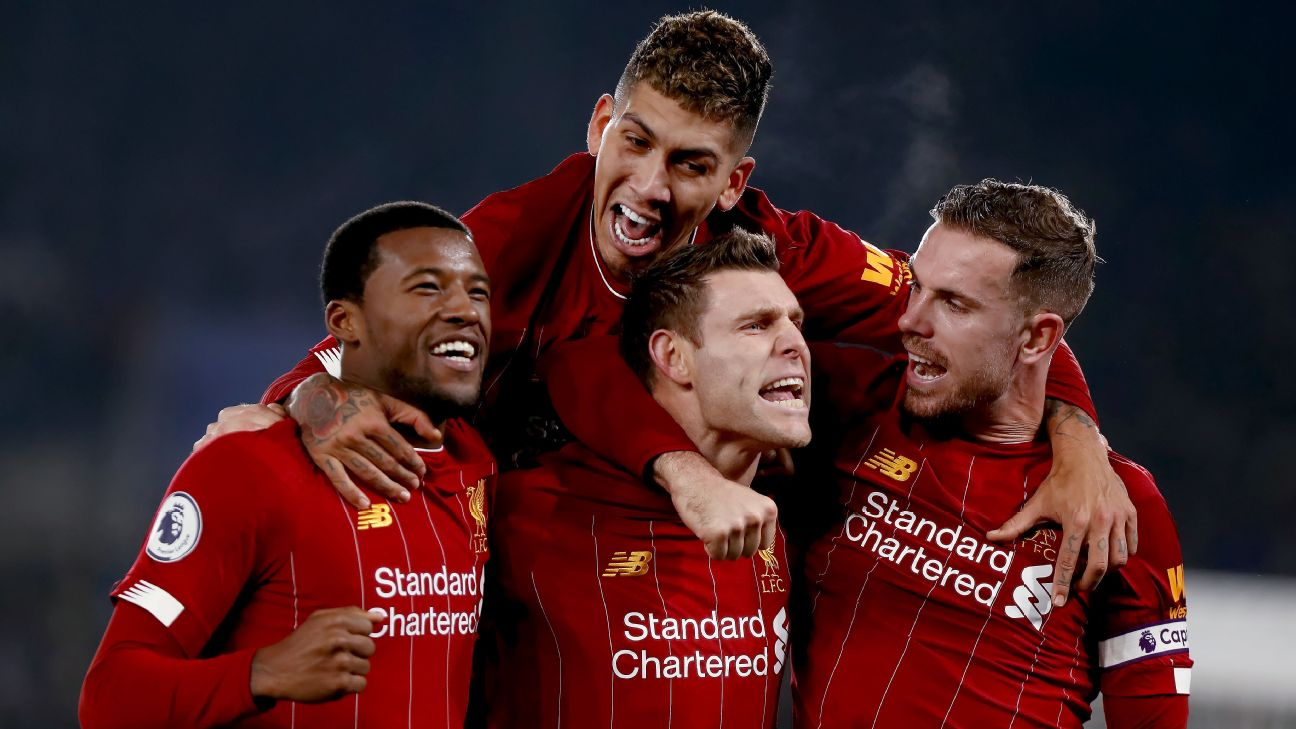 Liverpool players celebrate during their Premier League win over Leicester City.