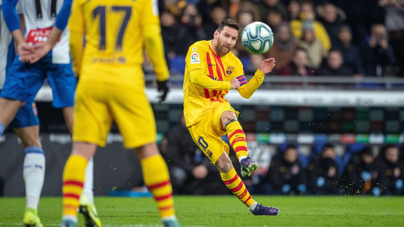 Lionel Messi strikes the ball during Barcelona's La Liga match against Espanyol.