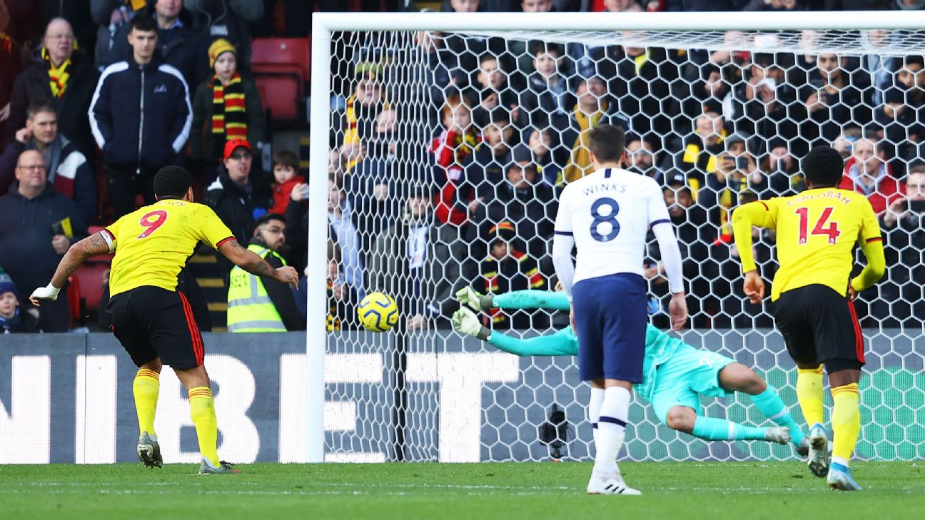 Paulo Gazzaniga of Tottenham Hotspur saves the penalty from Troy Deeney of Watford