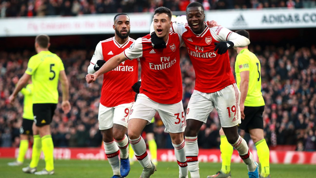 Arsenal's Gabriel Martinelli (centre) celebrates scoring his sides first goal of the game with Nicolas Pepe
