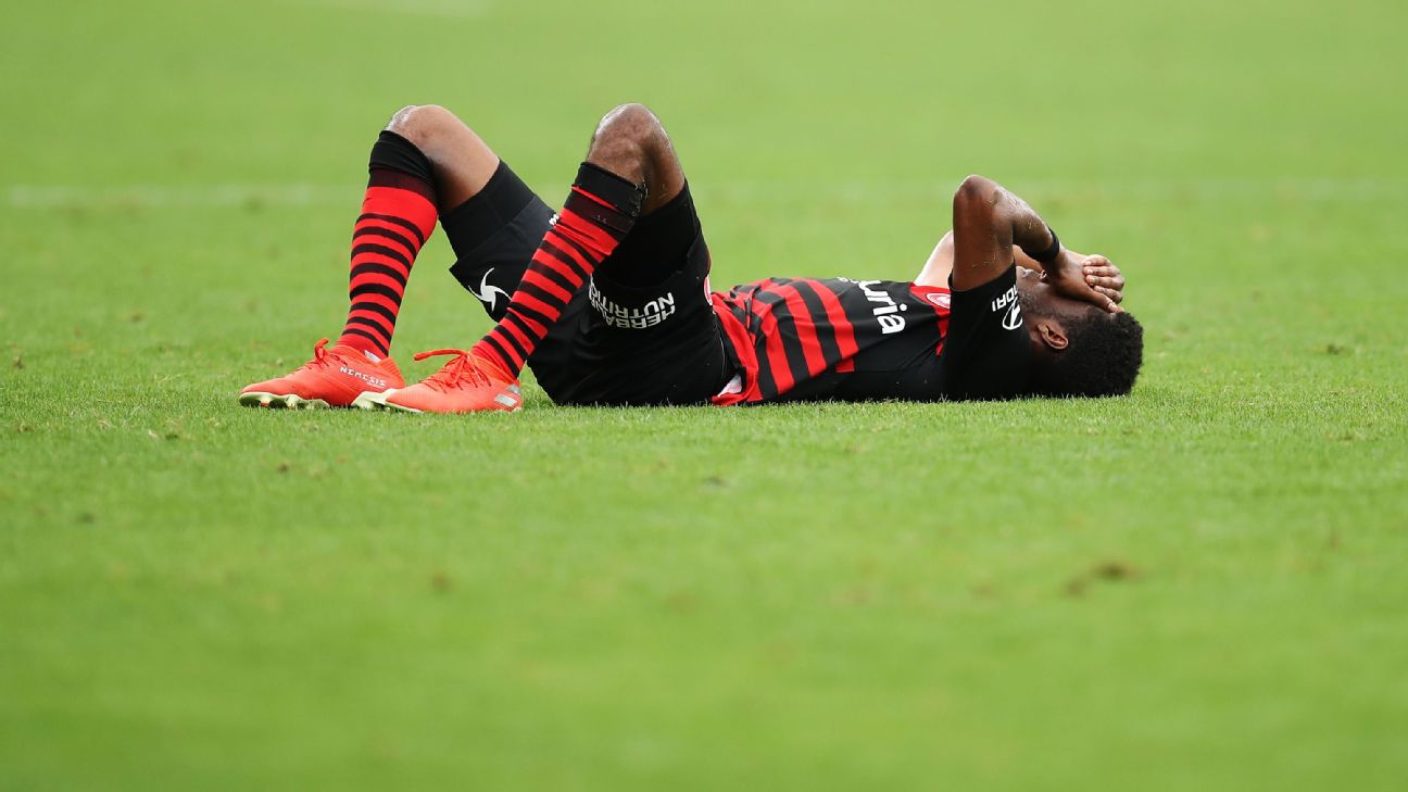 Bruce Kamau of the Wanderers lays on the ground