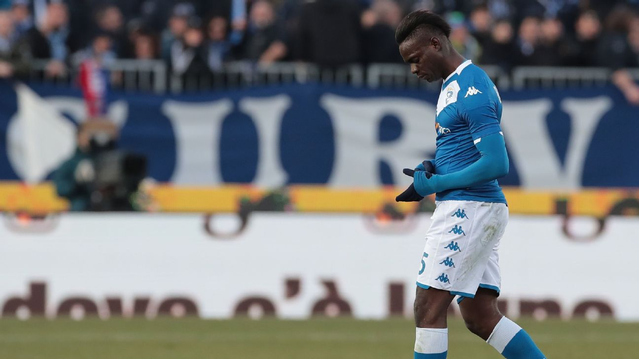 Mario Balotelli walks off after being red carded during Brescia's Serie A clash with Cagliari.