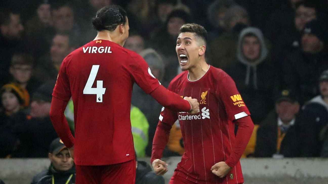 Virgil van Dijk and Roberto Firmino celebrate during Liverpool's Premier League win over Wolves.