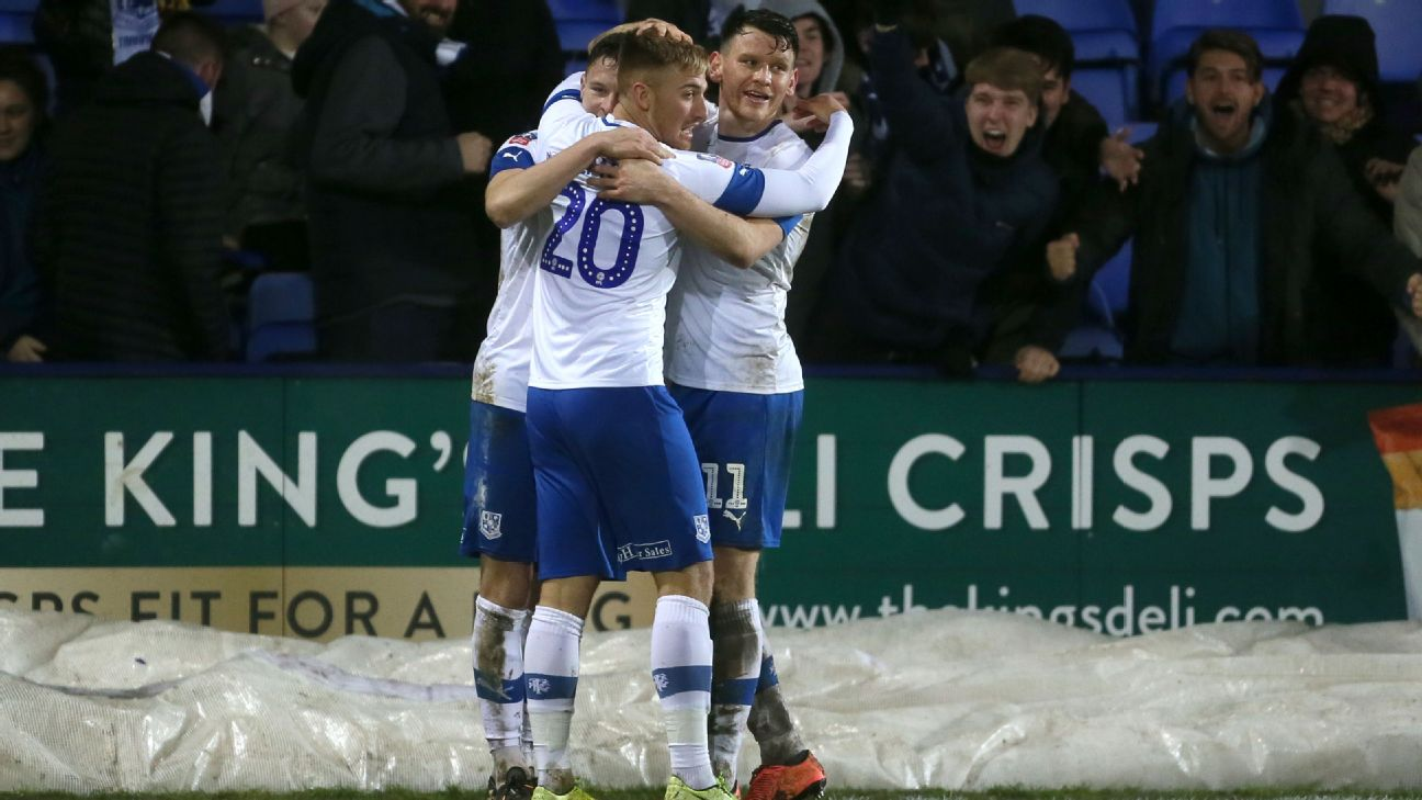 Tranmere Rovers players celebrate after scoring a goal against Watford in their FA Cup third-round replay.