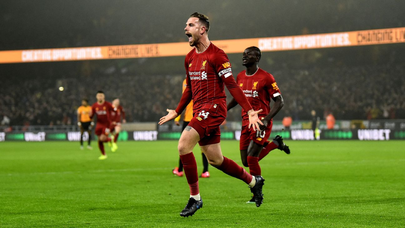 Jordan Henderson celebrates during Liverpool's Premier League win over Wolves.