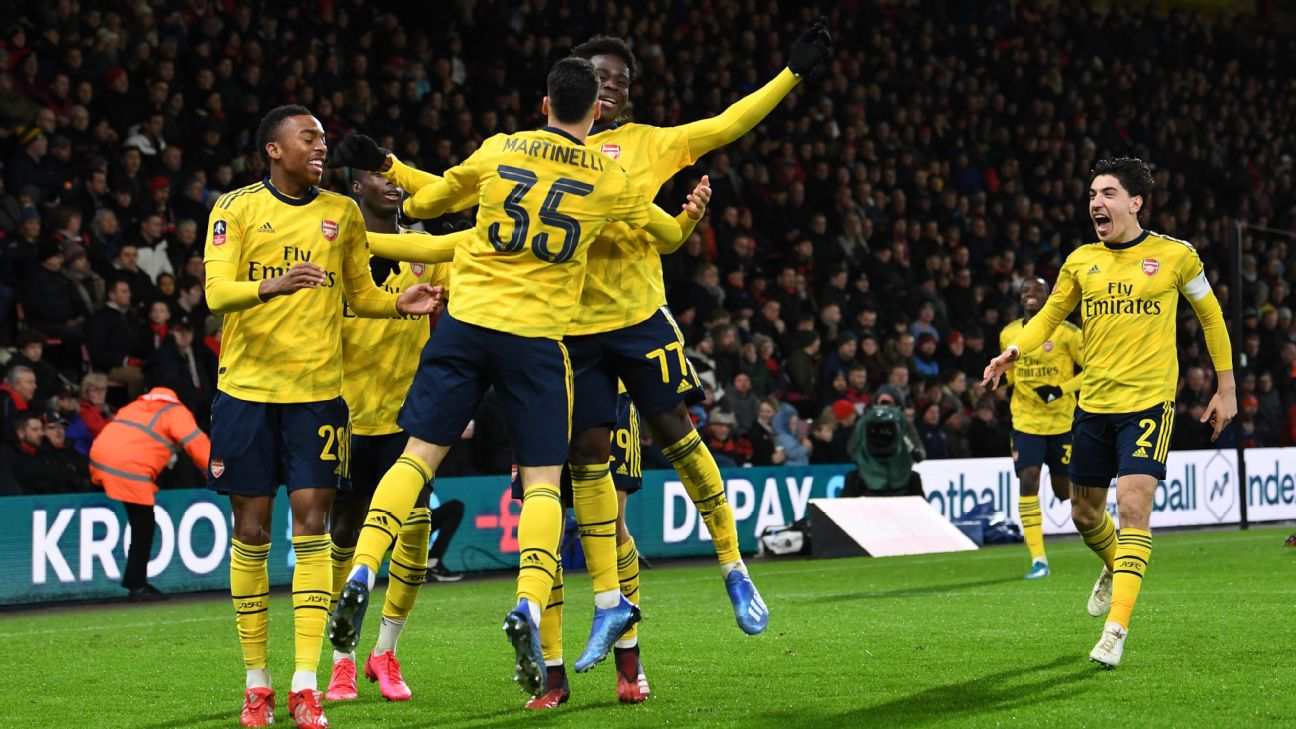 Bukayo Saka and Gabriel Martinelli celebrate with teammates during Arsenal's FA Cup win over Bournemouth.