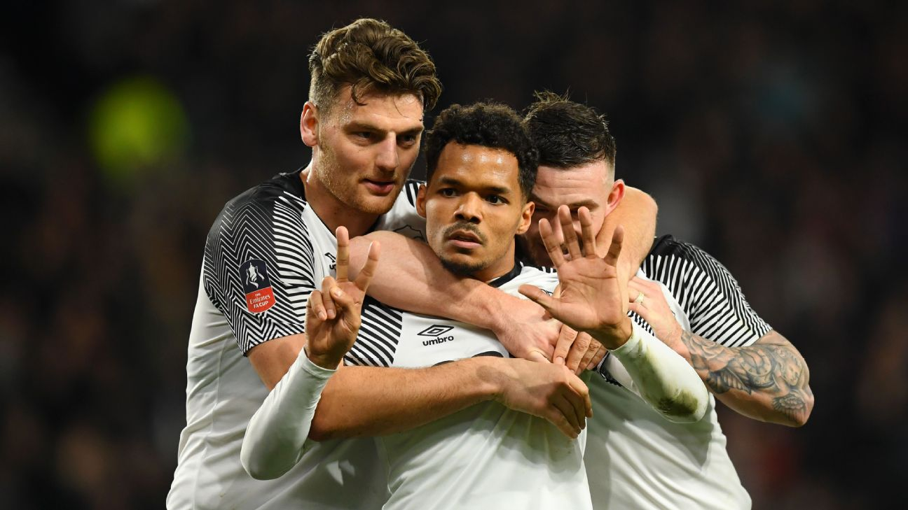 Duane Holmes celebrates with Derby County teammates during their FA Cup match against Northampton Town.