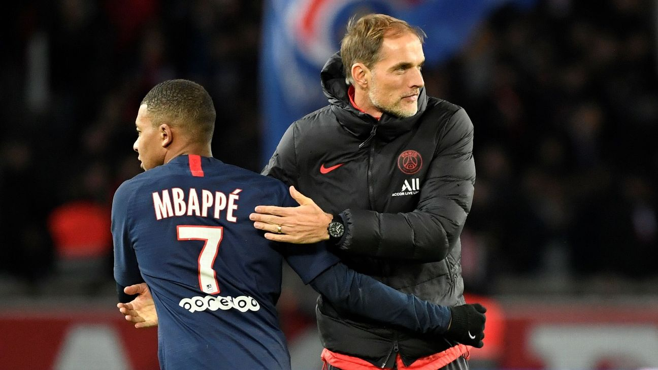Kylian Mbappe and Thomas Tuchel react during Paris Saint-Germain's Ligue 1 match against Lille.