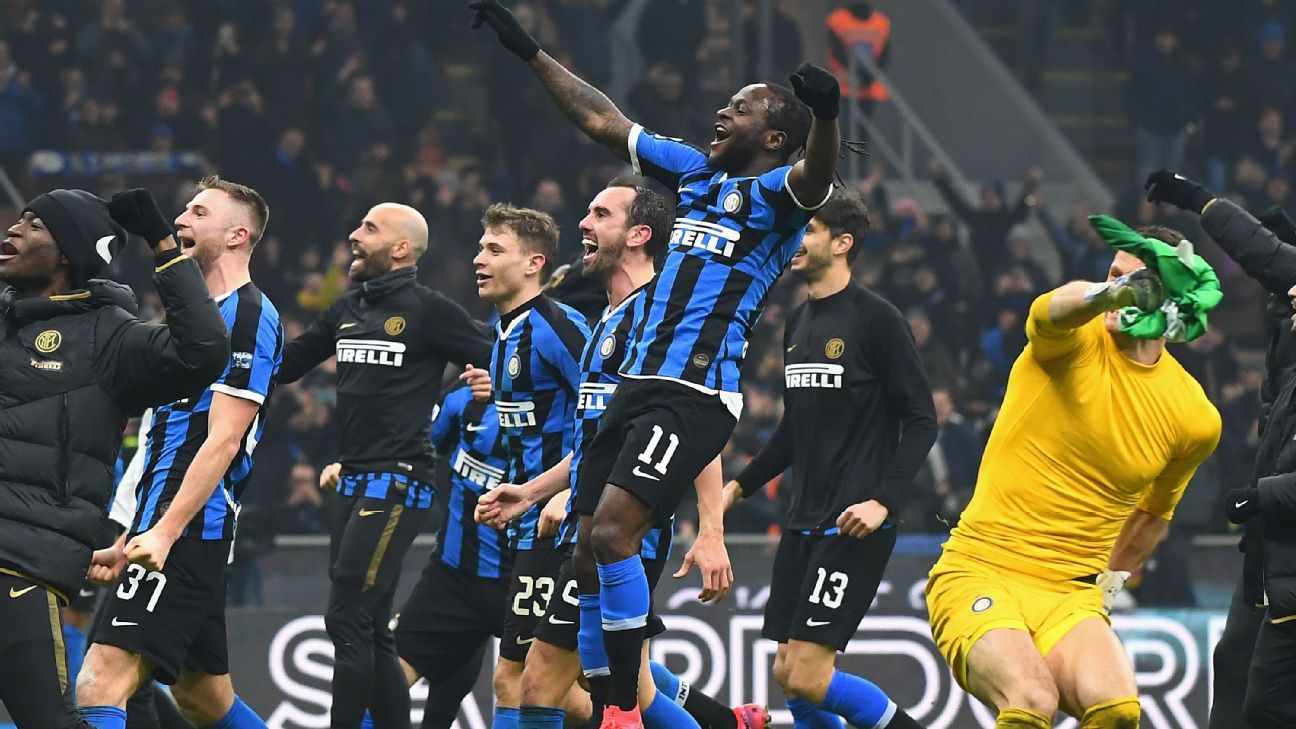 Victor Moses and Internazionale teammates celebrate victory in the Milan derby.