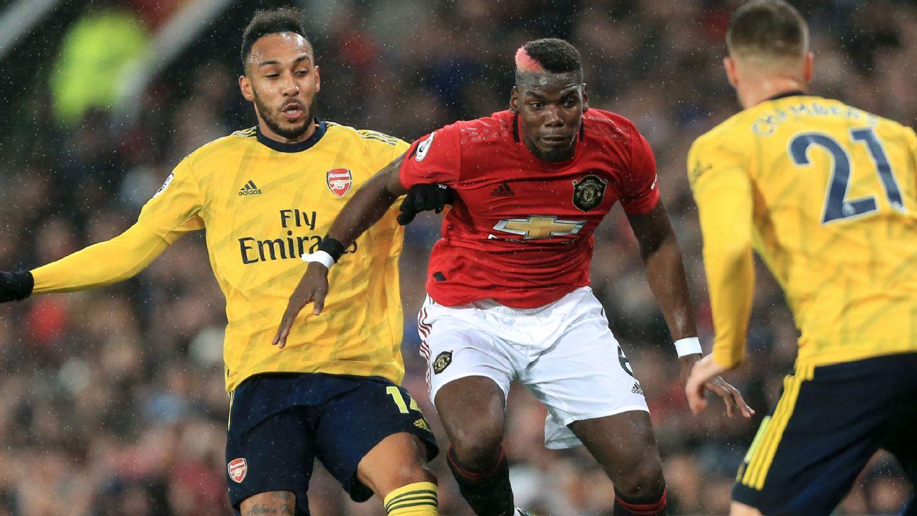 Pierre-Emerick Aubameyang of Arsenal and Paul Pogba of Man Utd