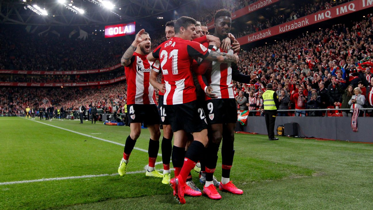 Athletic Bilbao players celebrate after scoring a goal against Granada in the Copa del Rey.