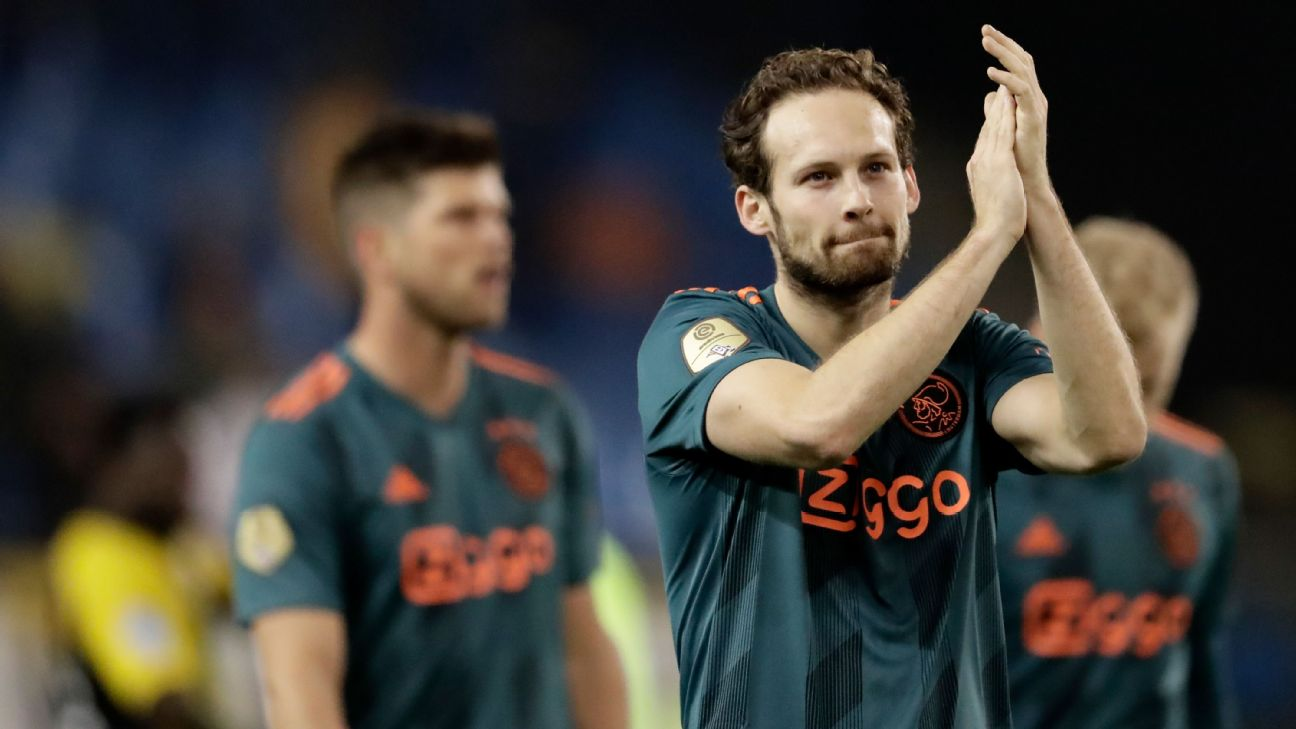 Daley Blind applauds the Ajax supporters after making his first appearance following December heart surgery.