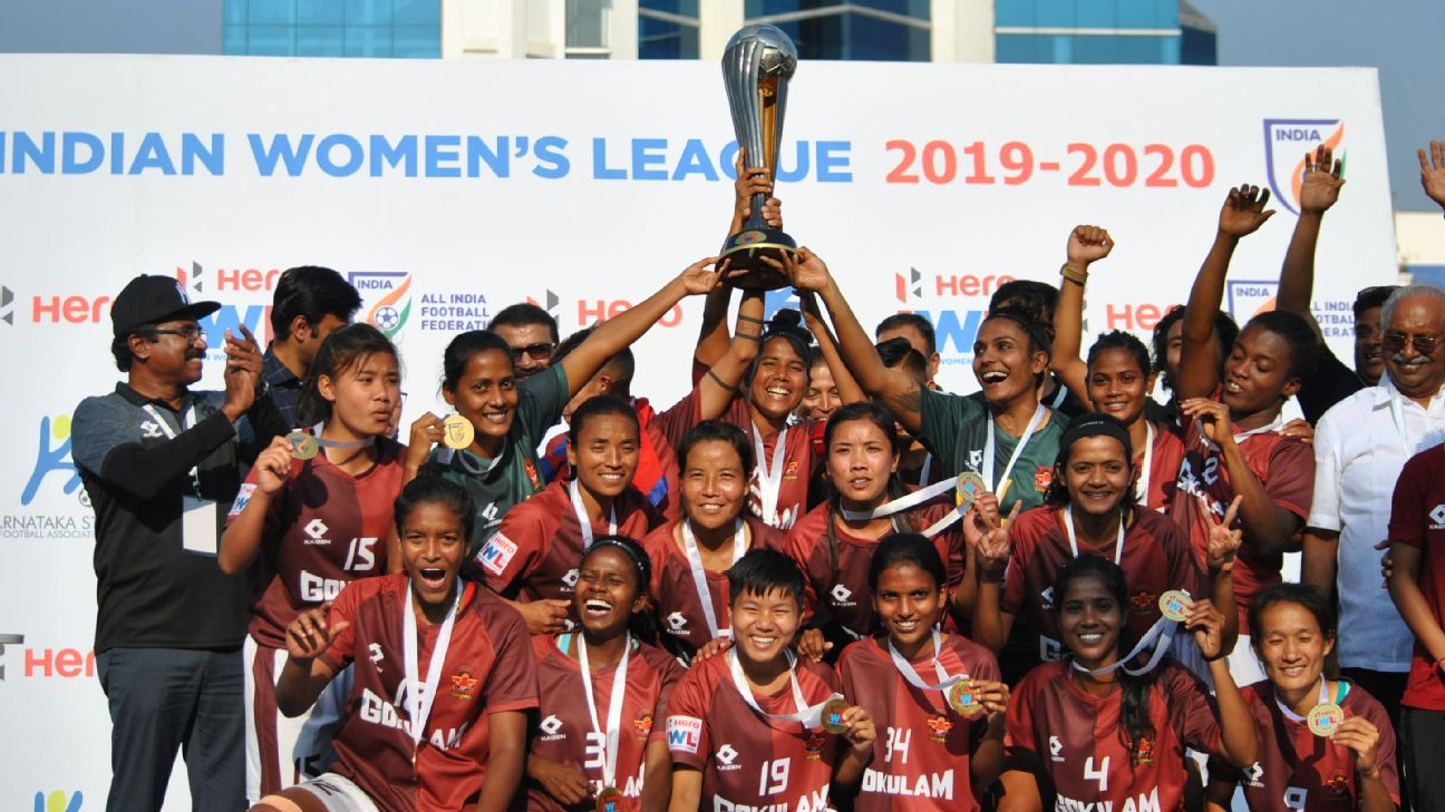 Gokulam Kerala players celebrate with the trophy after winning the 2020 IWL final.