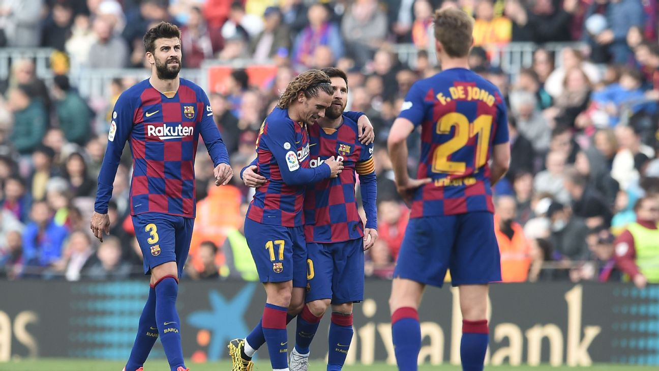 Antoine Griezmann, second from left, celebrates with Lionel Messi after scoring a goal for Barcelona.
