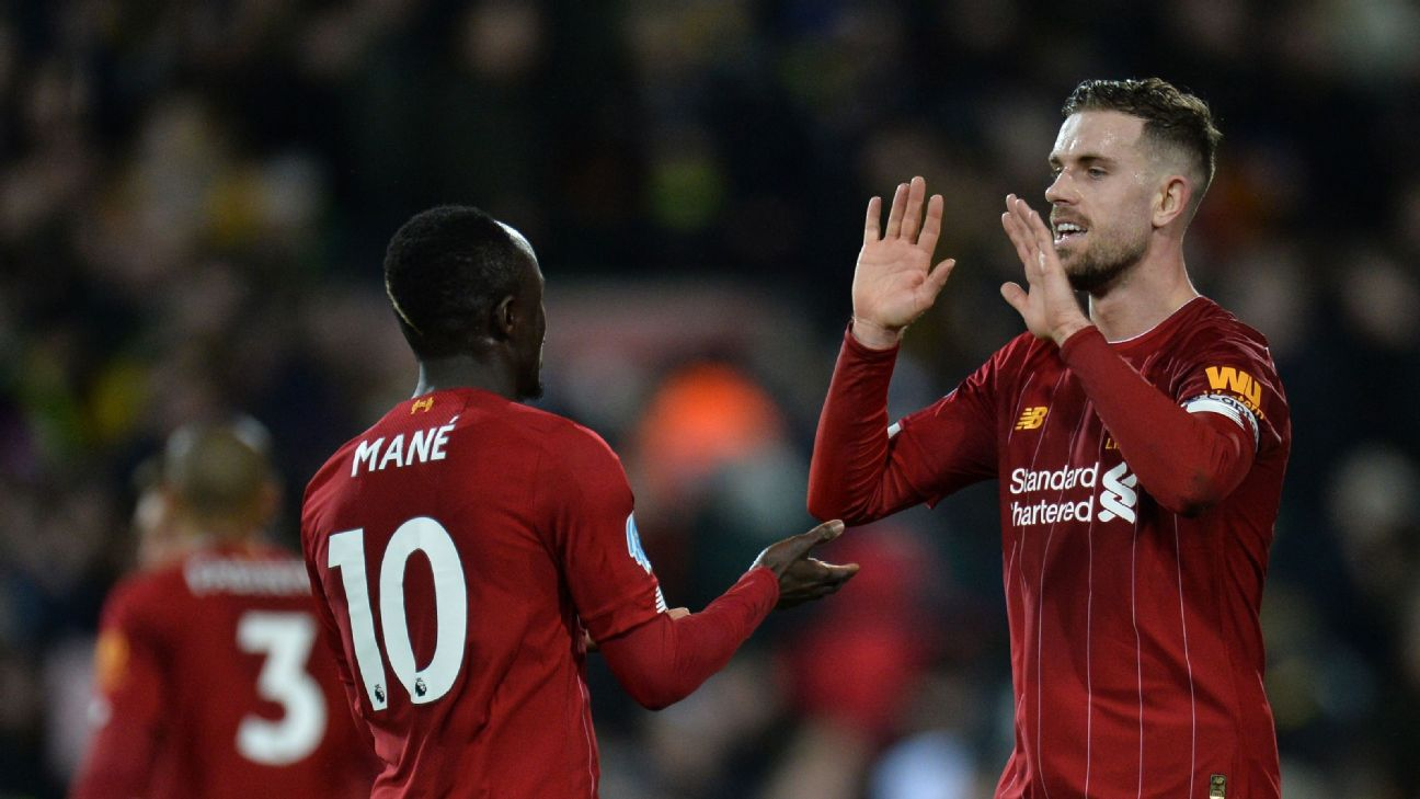 Sadio Mane and Jordan Henderson celebrate during Liverpool's Premier League win at Norwich.