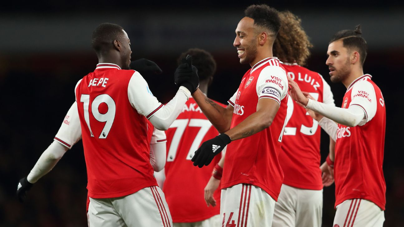 Nicolas Pepe and Pierre-Emerick Aubameyang celebrate after combining for Arsenal's opening goal vs. Newcastle United.