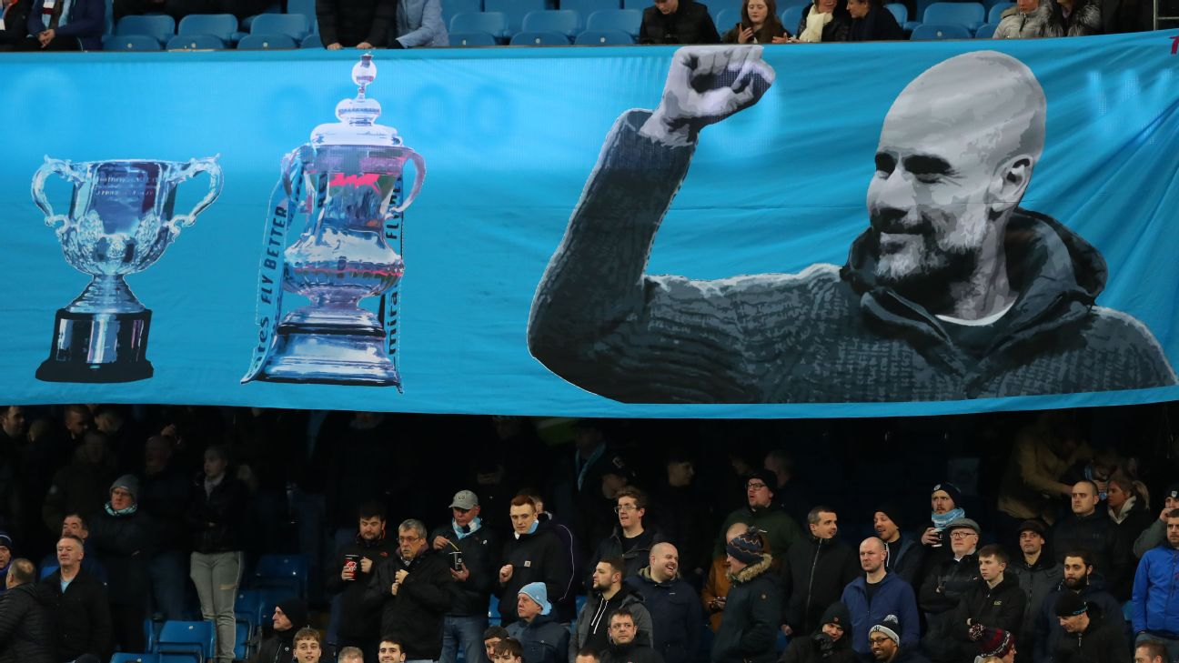 A banner showing Manchester City manager Pep Guardiola is flown during their match against West Ham.