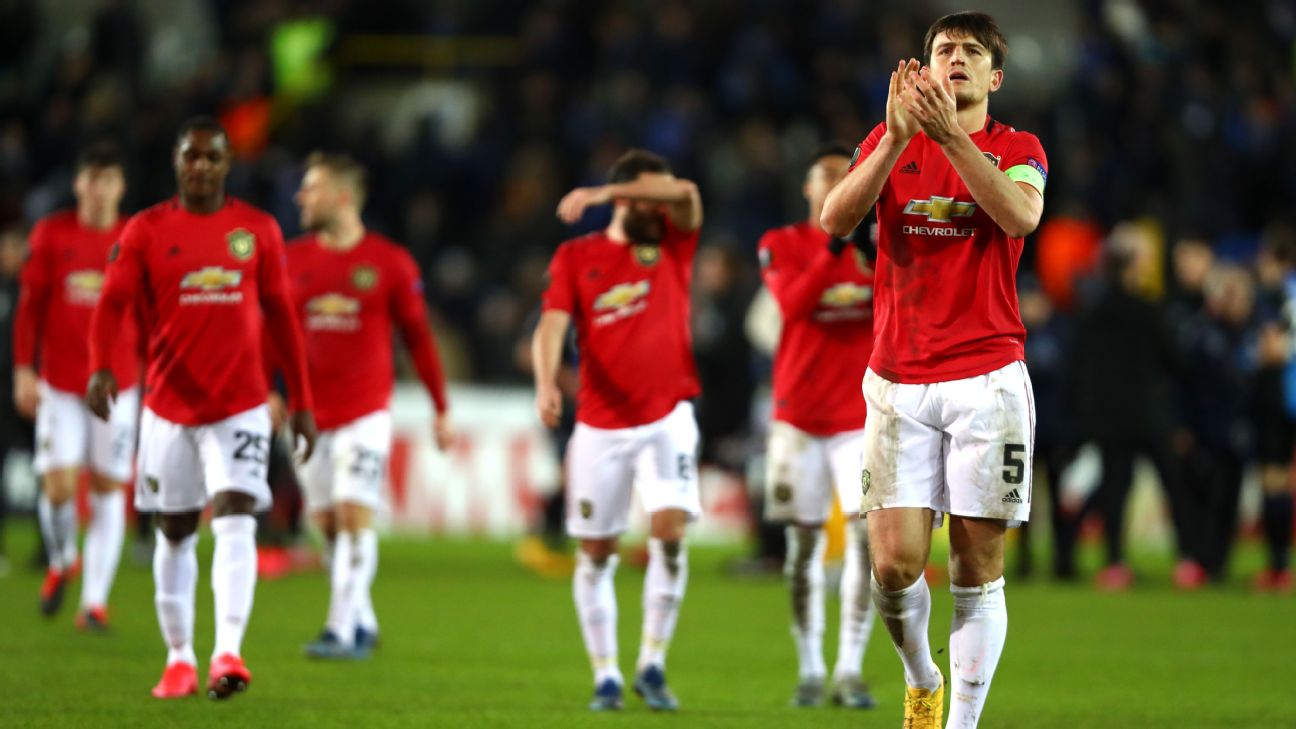 Harry Maguire applauds supporters after Manchester United's Europa League draw at Club Brugge.