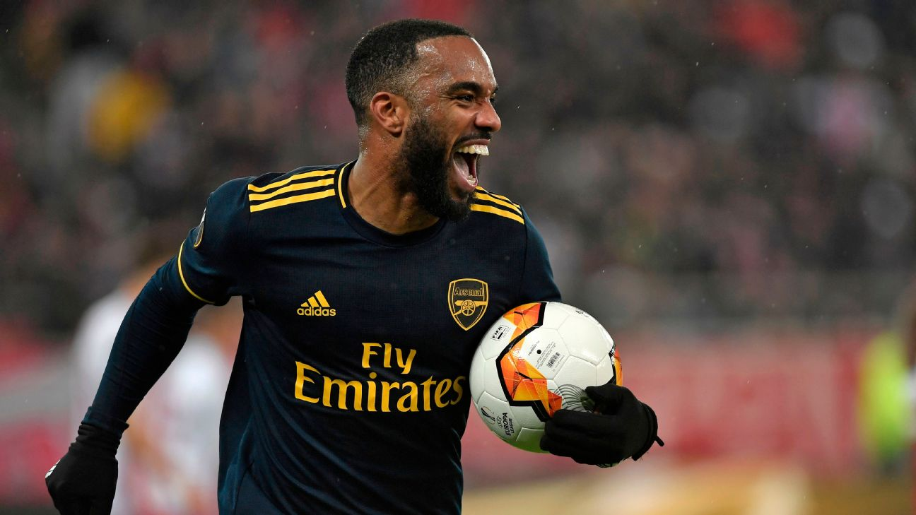 Alexandre Lacazette celebrates after scoring in Arsenal's Europa League match at Olympiakos.