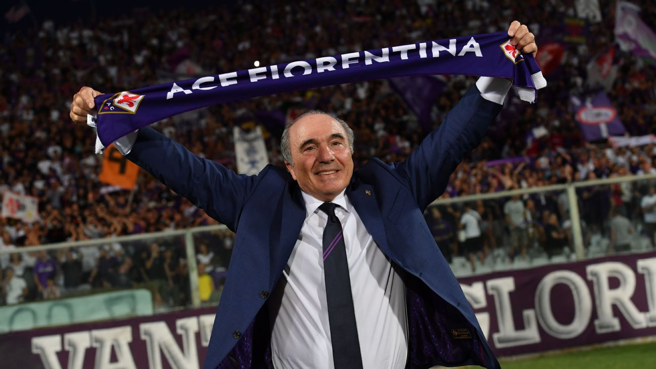 Rocco Commisso holds up a scarf ahead of Fiorentina's Serie A match against Napoli.
