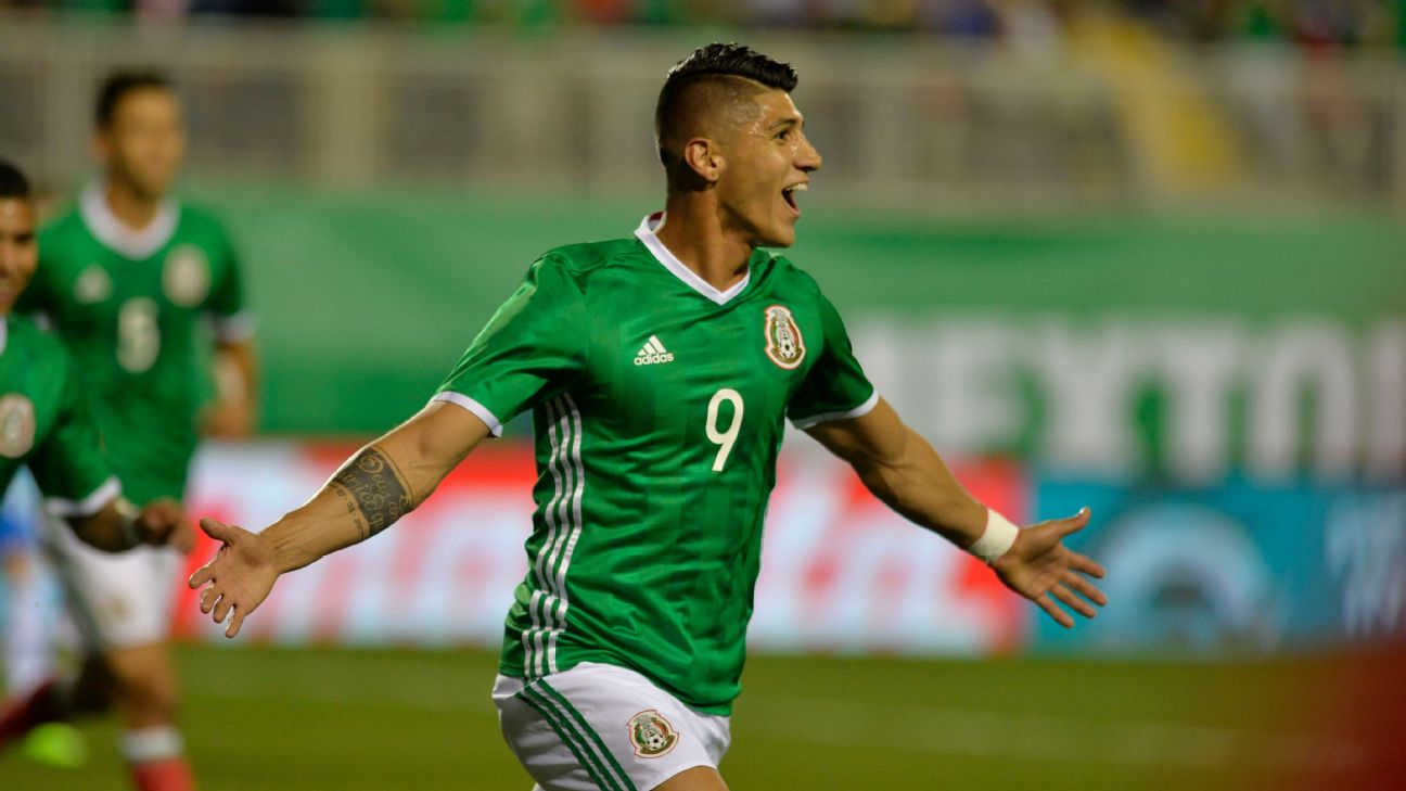 Alan Pulido celebrates after scoring in Mexico's friendly against Iceland.