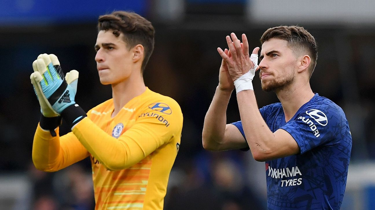 Kepa and Jorginho applaud supporters after Chelsea's Premier League win against Brighton.
