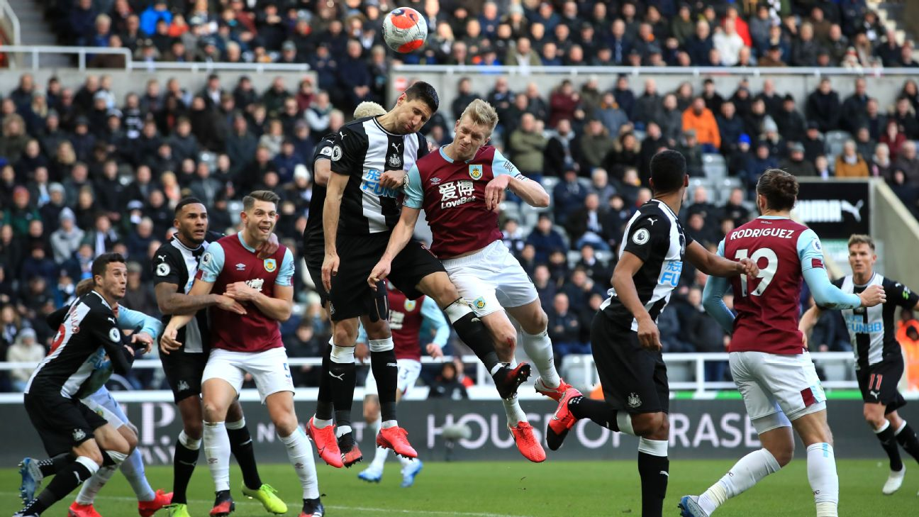 Burnley's Ben Mee and Newcastle United's Federico Fernandez (centre left) contest a header