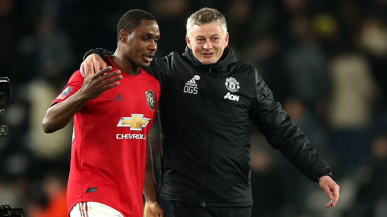 Odion Ighalo and Ole Gunnar Solskjaer celebrate after Manchester United's FA Cup win over Derby County.