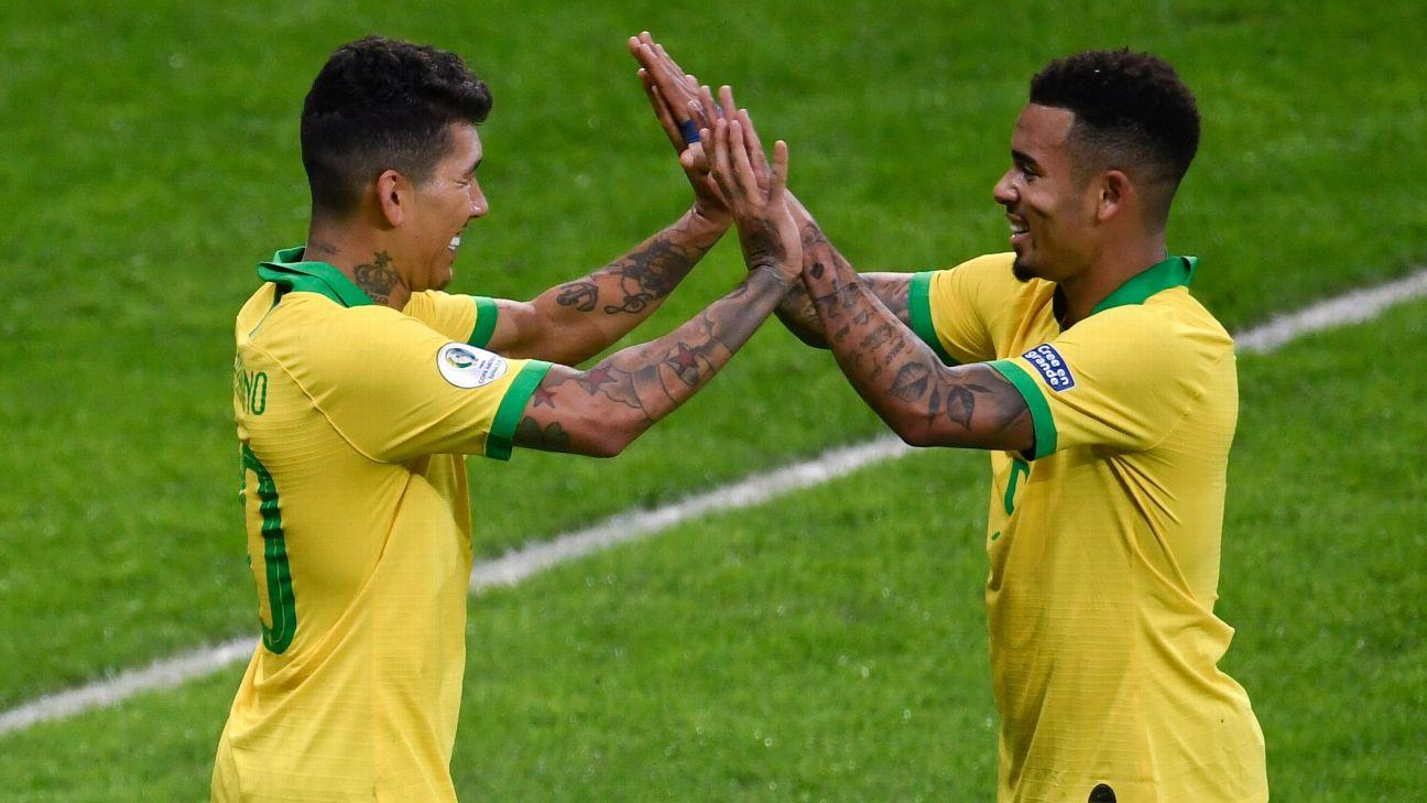 Roberto Firmino and Gabriel Jesus celebrate during Brazil's Copa America win over Argentina.