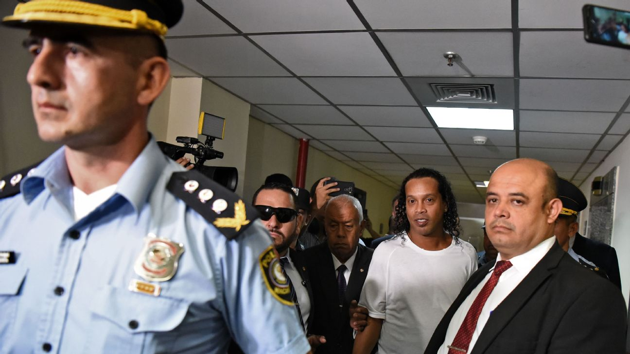 Brazilian retired football player Ronaldinho arrives at Asuncion's Justice Palace to testify.
