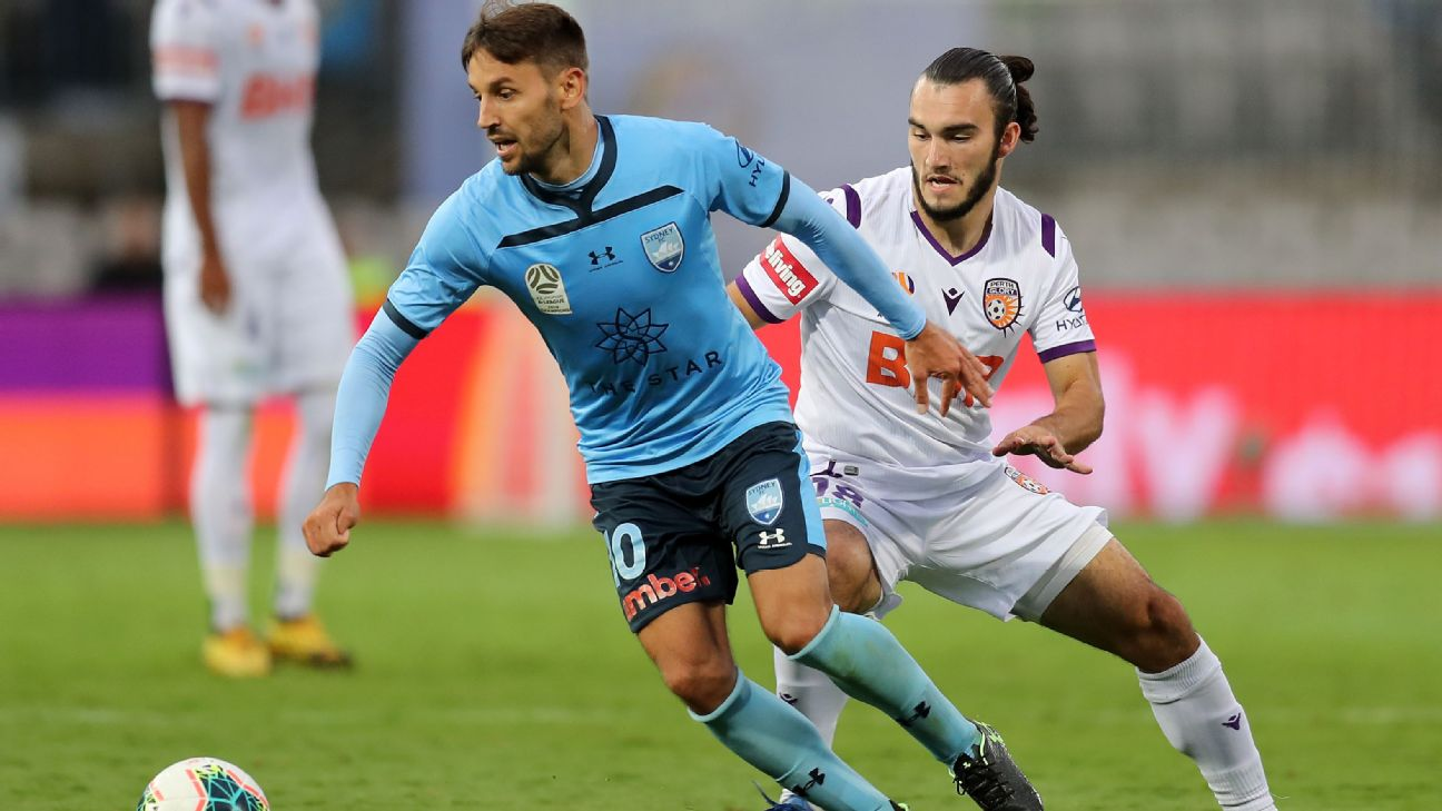 Milos Ninkovic of Sydney FC and Nicholas D'agostino of Perth Glory