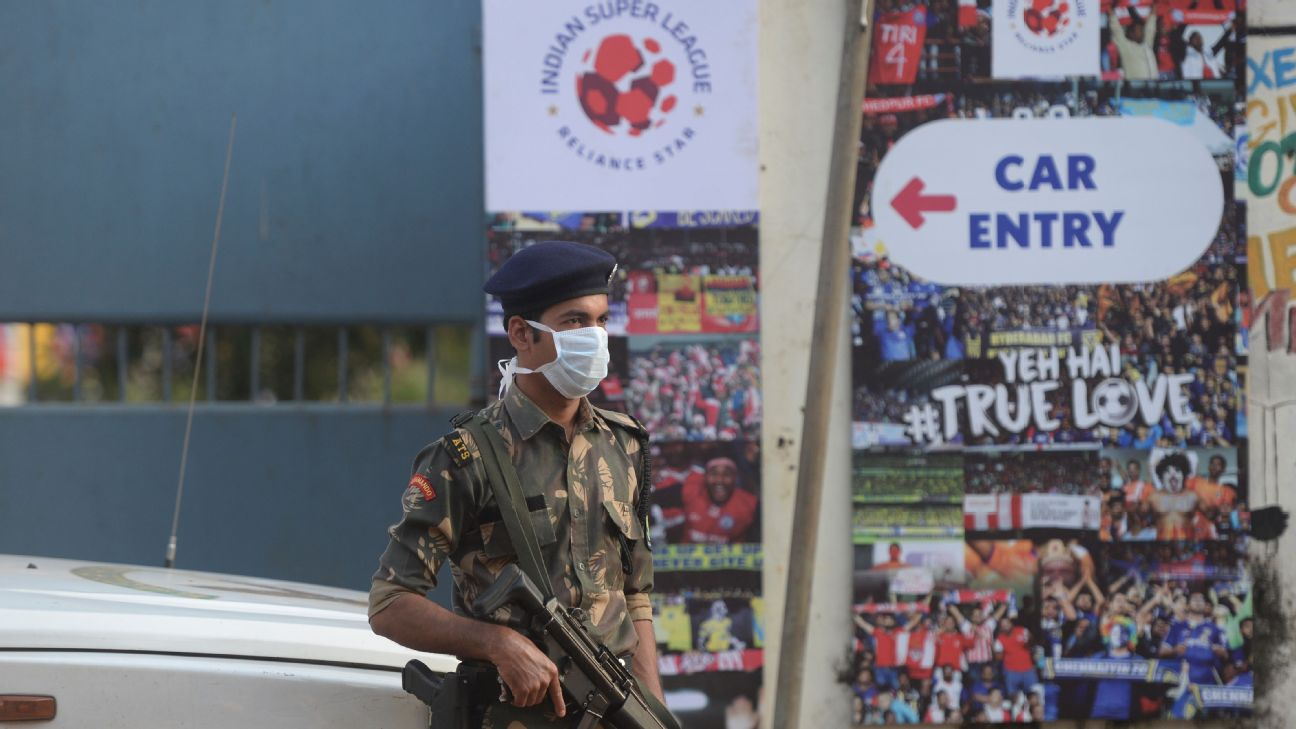 A security personnel wears a facemask as he stands guard outside the Nehru Stadium, Margao ahead of the Indian Super League (ISL) final between ATK and Chennaiyin FC.