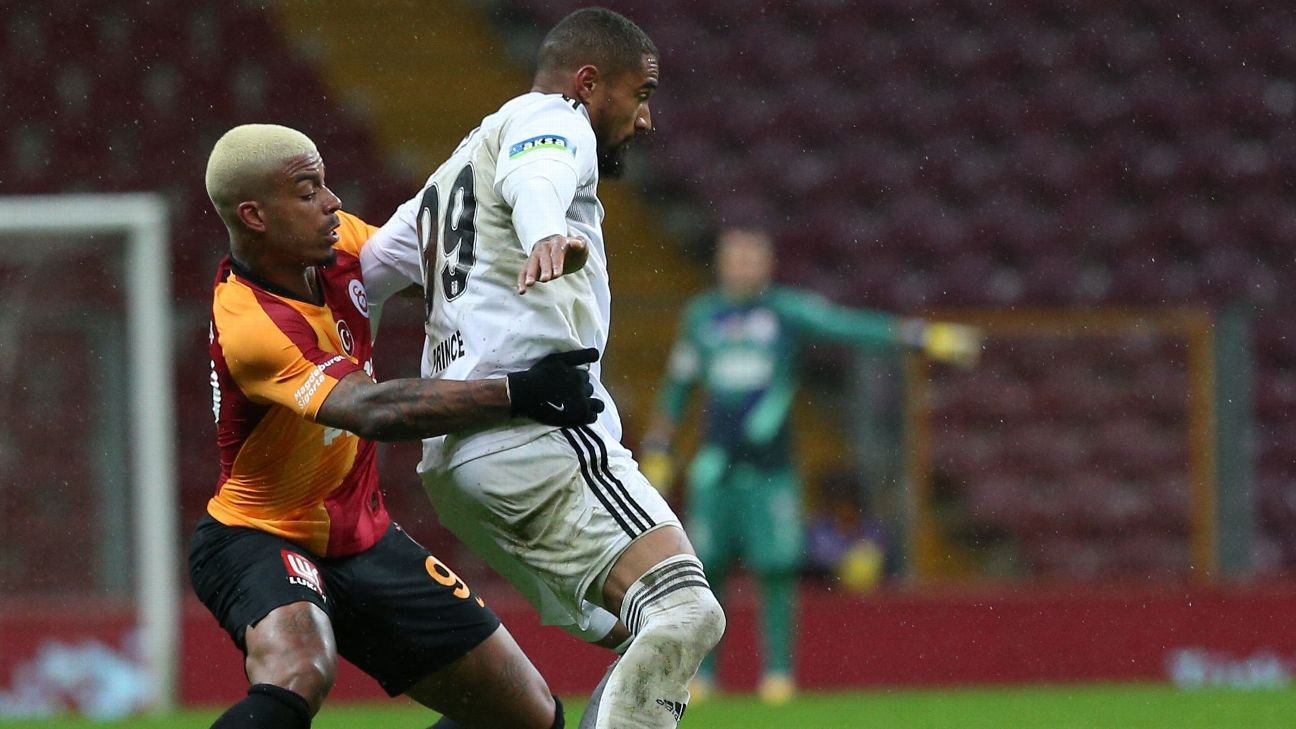 Kevin-Prince Boateng (right) comes under pressure from Mario Menina.