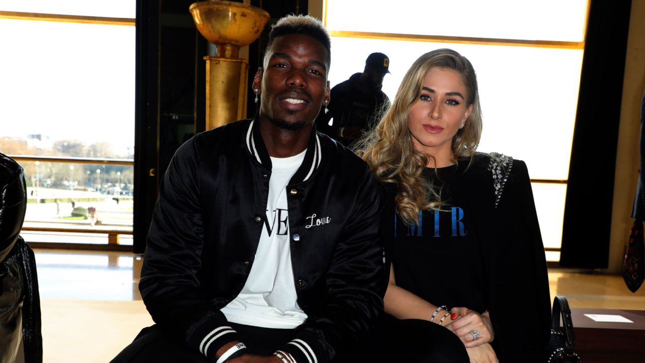 Paul Pogba and his wife Maria Salaues attend the Amiri Menswear Fall/Winter 2020-2021
