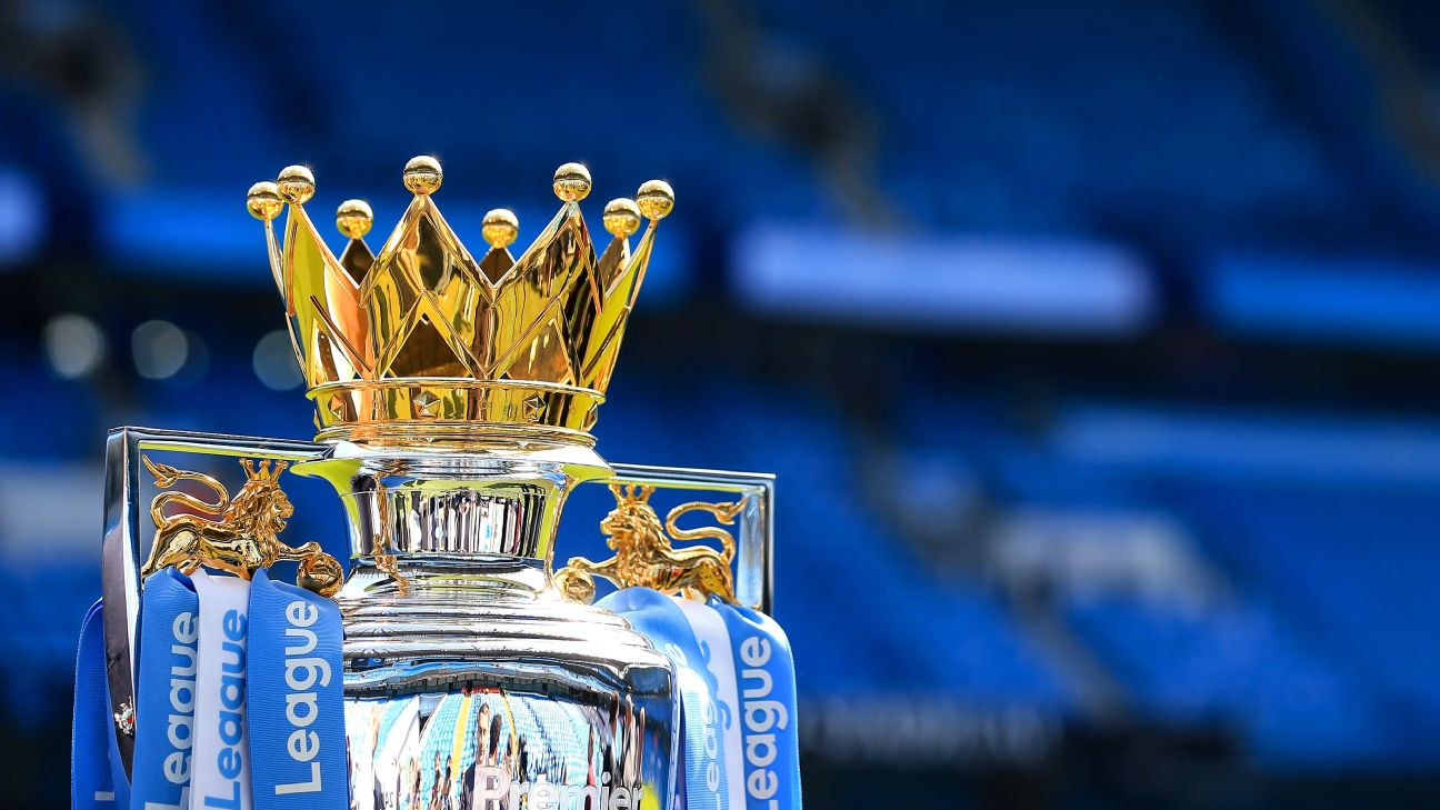 The Premier League trophy awaits Manchester City at the Etihad Stadium.
