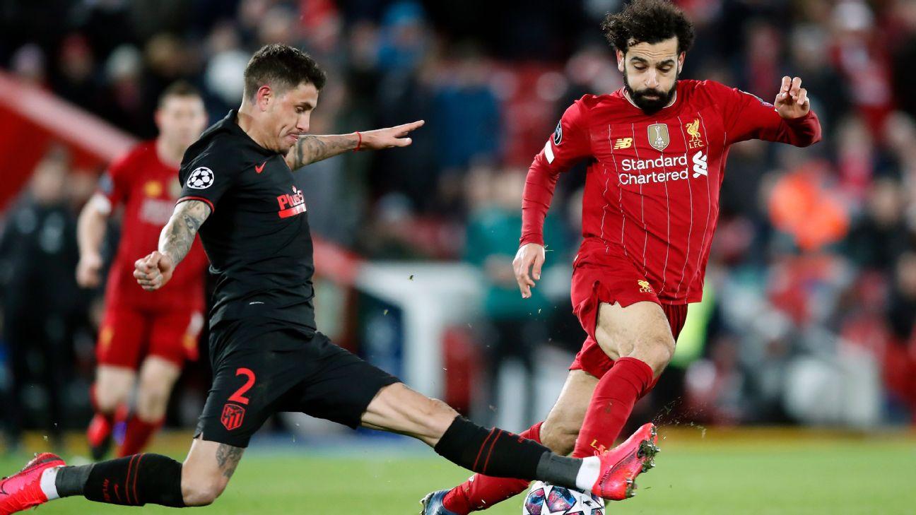 Jose Maria Gimenez and Mohamed Salah