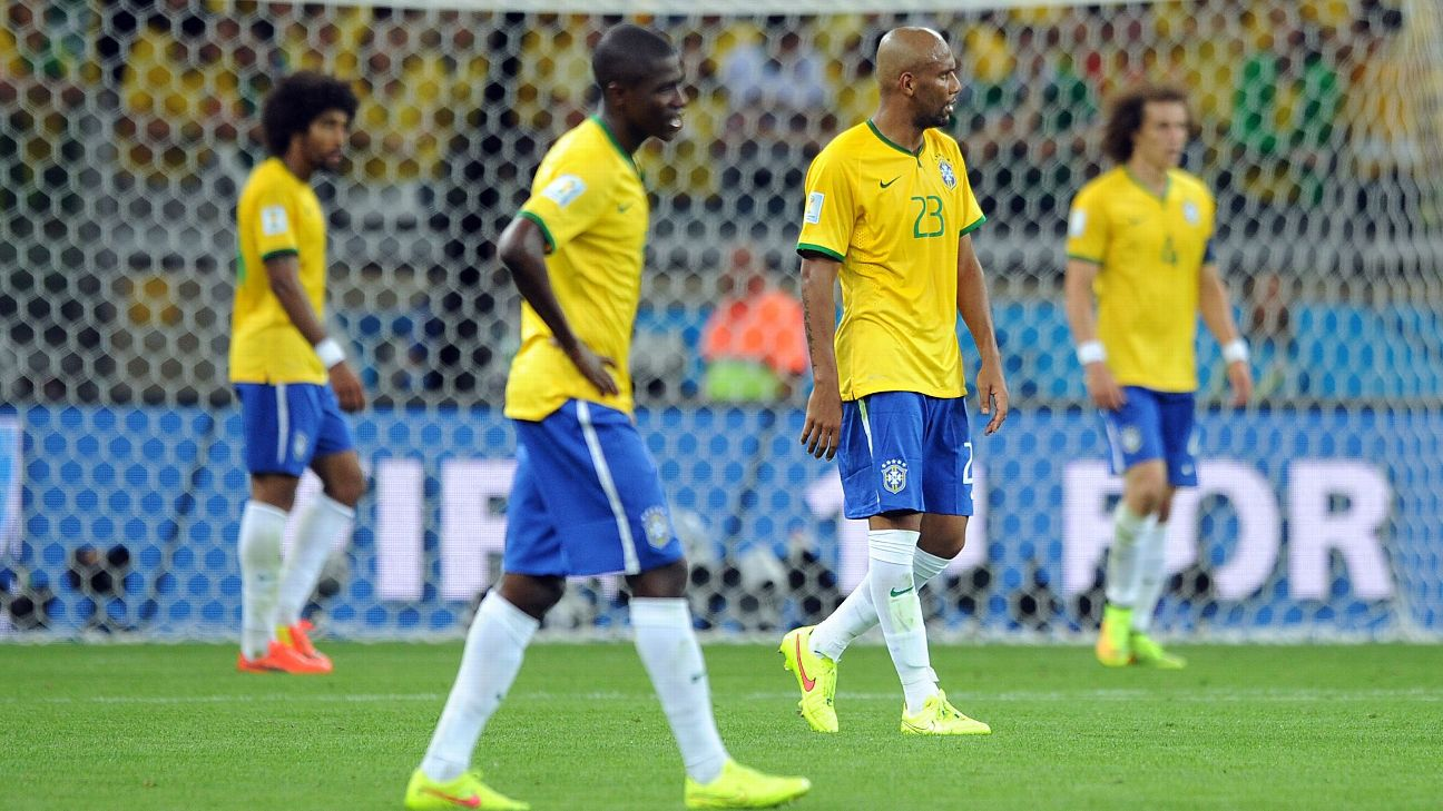 Brazil players react after losing 7-1 to Germany in the World Cup semifinal in 2014.