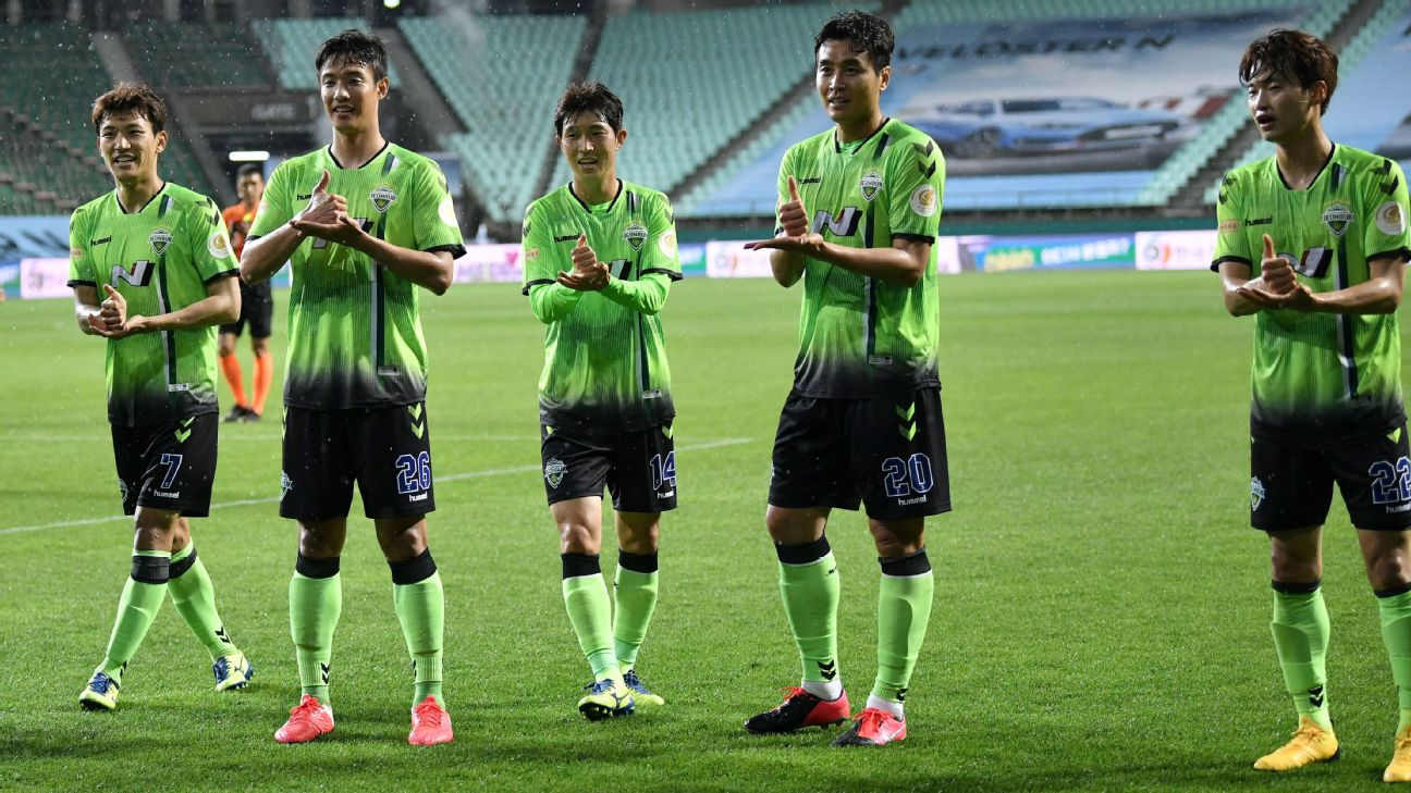 Jeonbuk Hyundai Motors' players celebrate after scoring a goal in the K-League's first game of the season.