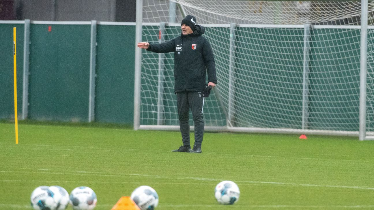 Augsburg coach Heiko Herrlich will miss his first match in charge of the team after breaking quarantine.