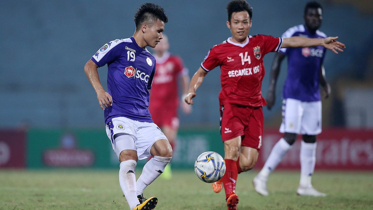 Nguyen Quang Hai, photographed (left) playing for Hanoi FC vs. V.League 1 rivals Becamex Binh Duong in the AFC Cup last season, is the biggest name in Vietnamese soccer.