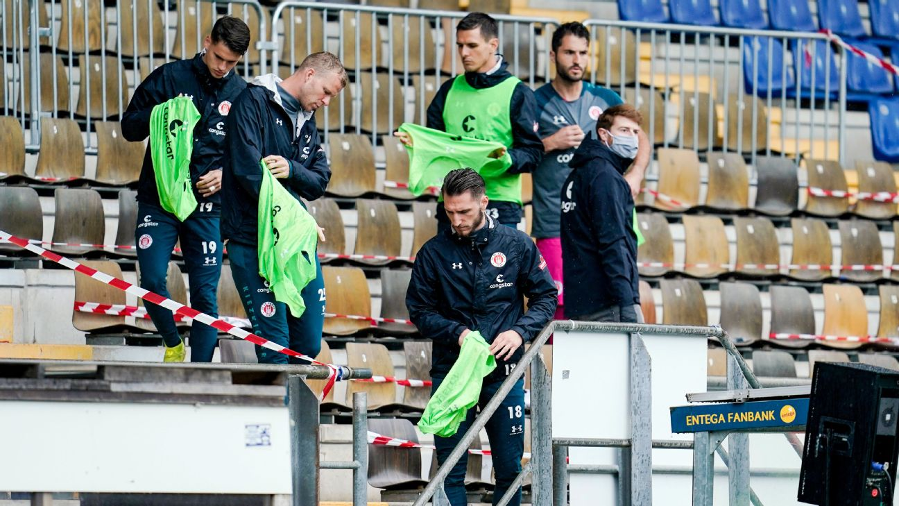 substitute players Luca-Milan Zander (front L-R) Henk Veerman and Dimitrios Diamantakos of FC St. Pauli are seen in the stands