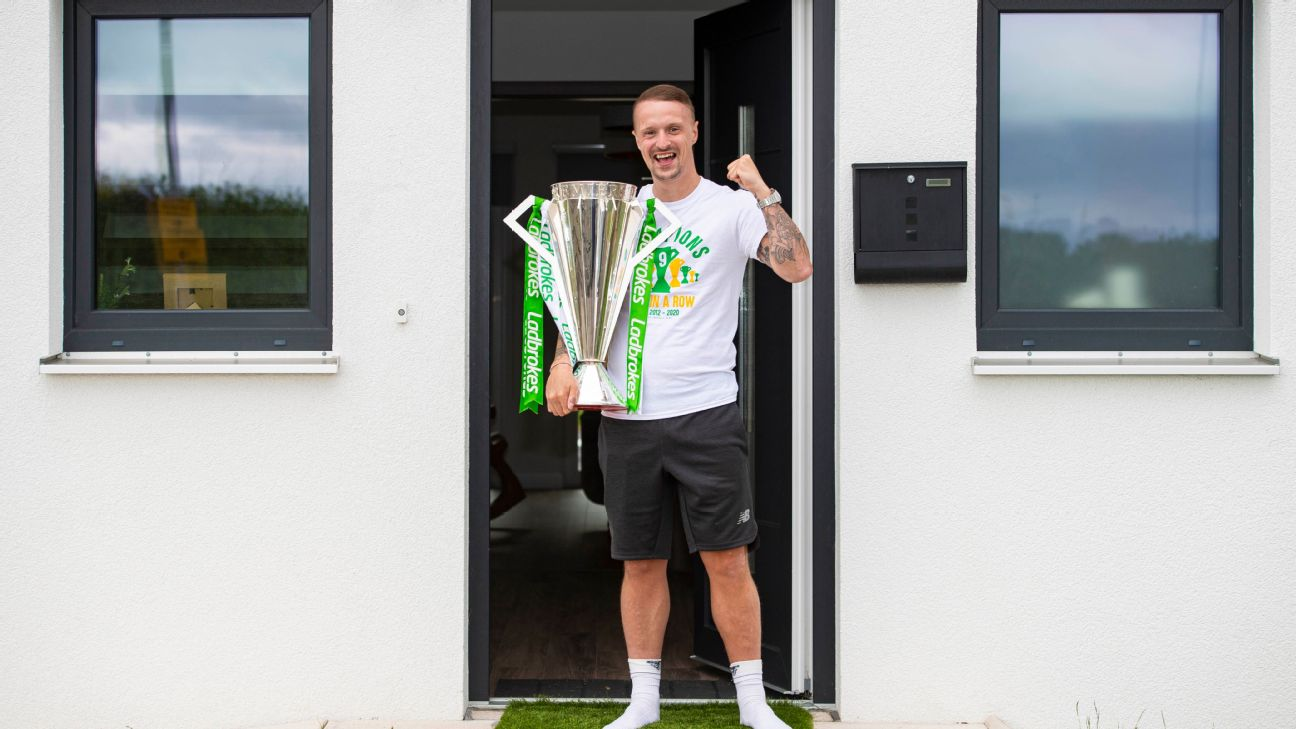 Leigh Griffiths is pictured with the Ladbrokes Premiership trophy which has been delivered to his house