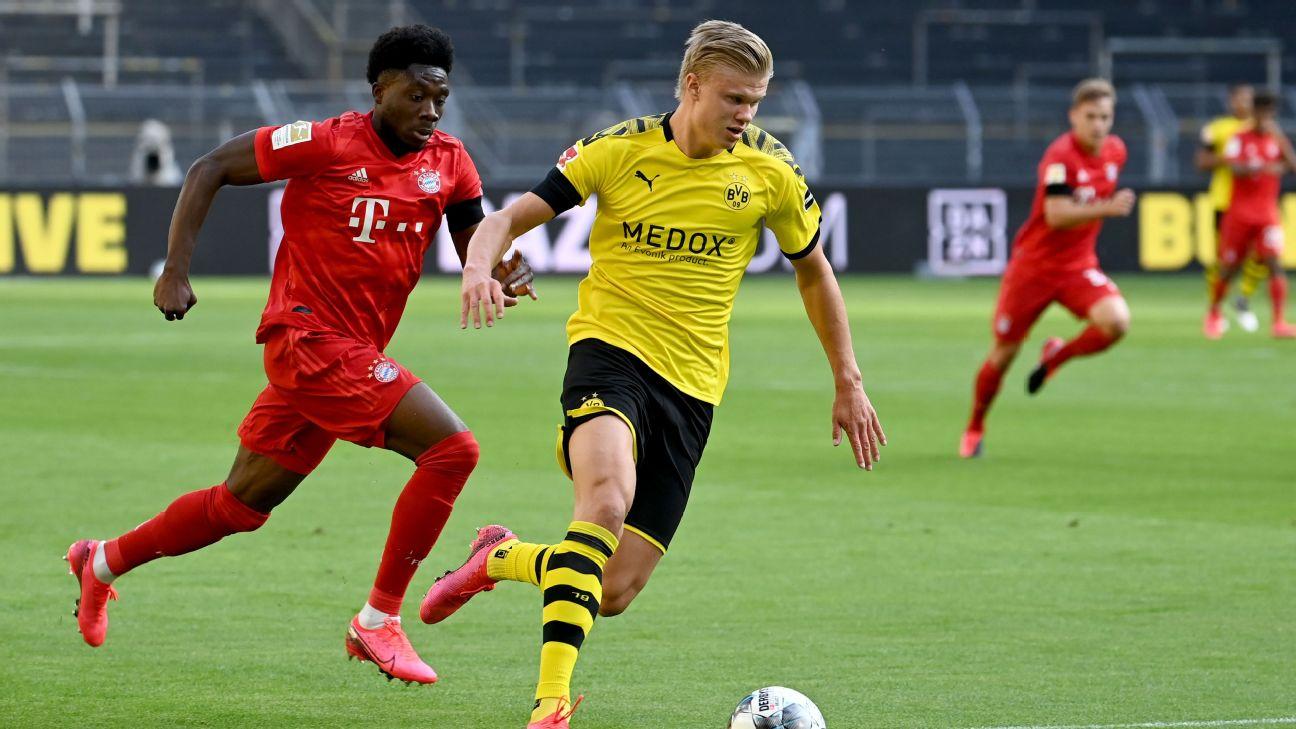 Bayern Munich's Alphonso Davies, left, chases down Borussia Dortmund's Erling Haaland.