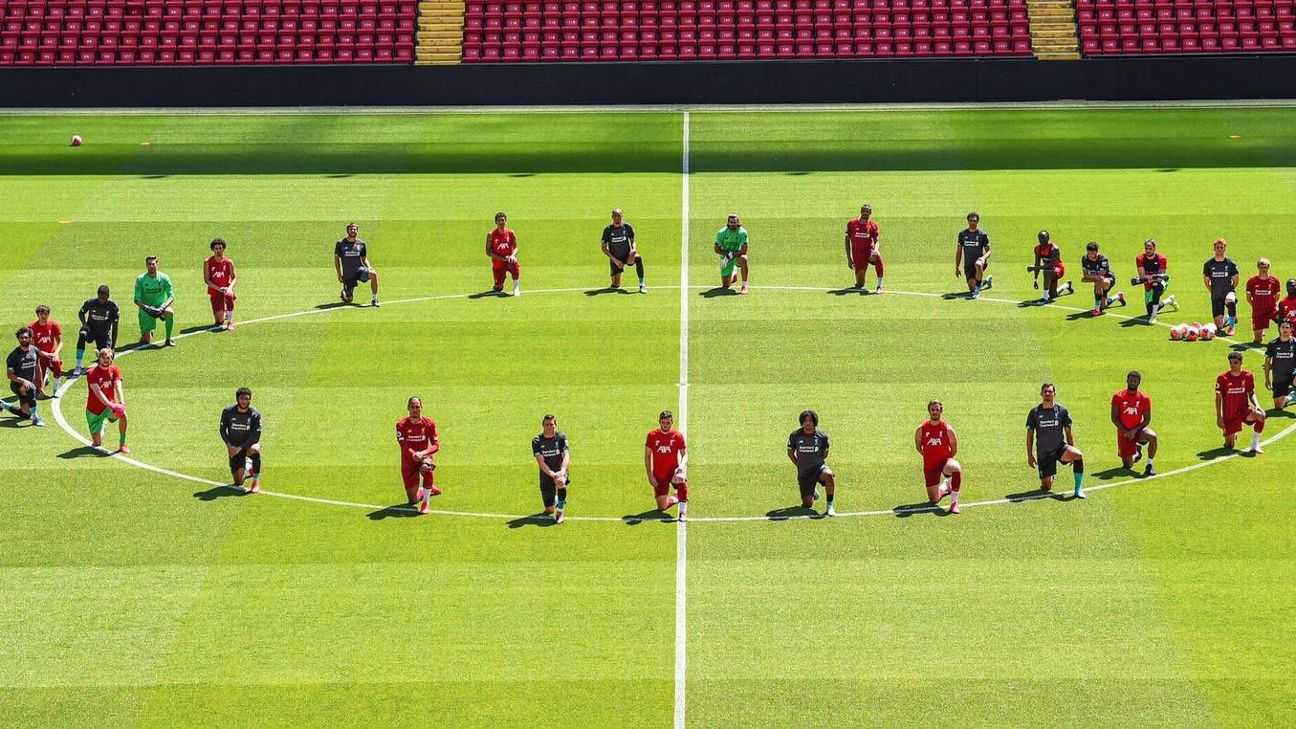Liverpool players kneel in support of George Floyd.