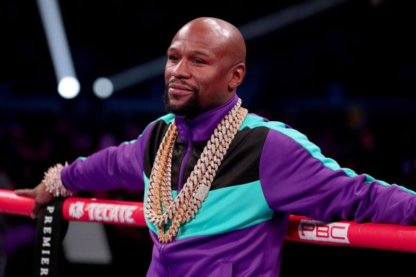 Mayweather critical of number of title belts