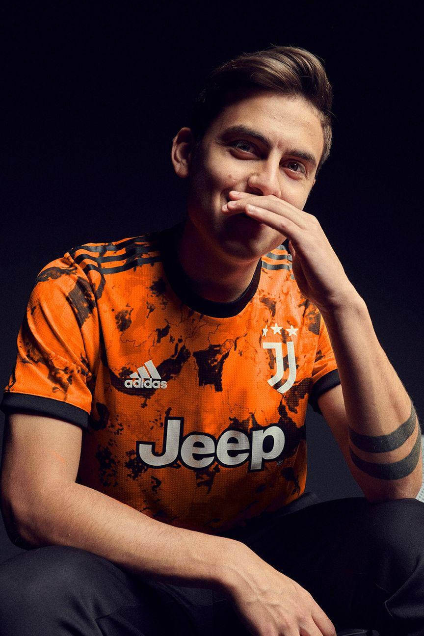 cristiano ronaldo unveils juventus bold orange third kit for 2020 21 cristiano ronaldo unveils juventus
