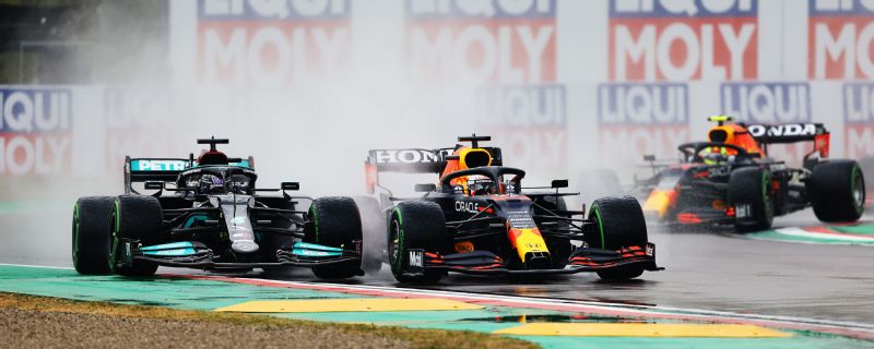 Max Verstappen forces his way past Lewis Hamilton on the opening lap.